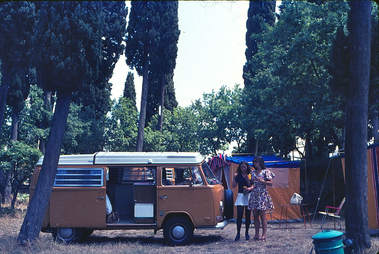 In Germany in 1972, I love how dressed up they both are, my Mom is in the floral dress. We had those orange tents my entire childhood.