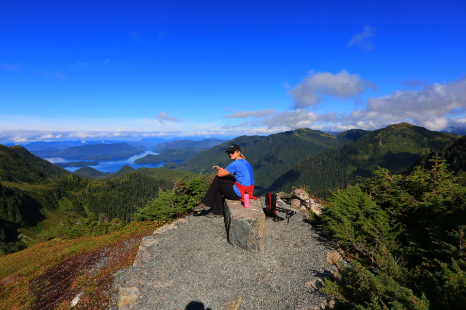 Erica enjoys the view on the Harbor Mountain Trail in Sitka, Alaska.