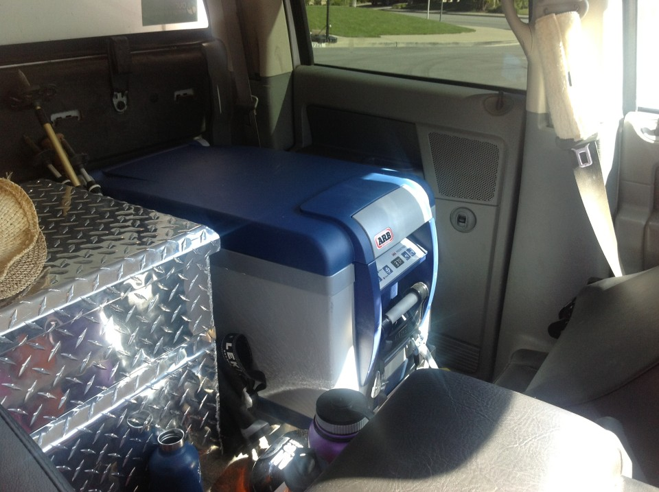 We added a second ARB refrigerator/freezer right behind the driver's seat.  Marc and his team at XPCamper made a mount that holds it secure and did the install.