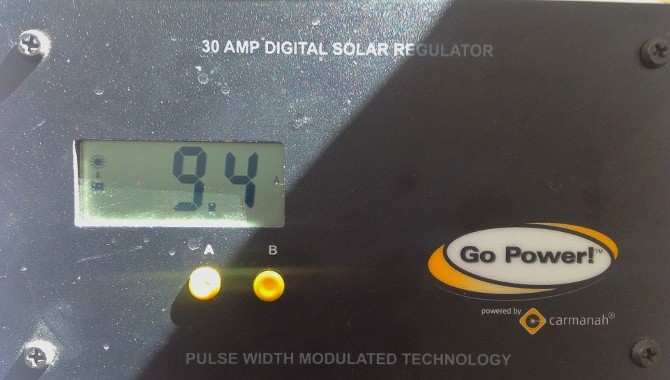 It was a sunny day and the battery was already topped off.  This shows 9.4 amps being generated by our solar system after I turned on all the lights, the two fans, and the refrigerator in our camper.