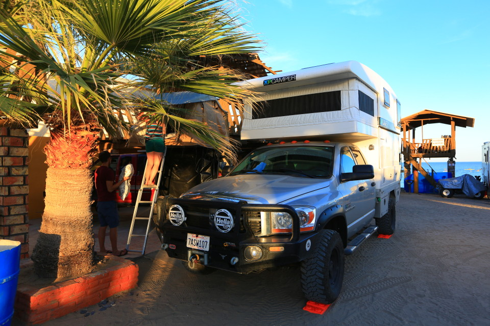 We smashed both our trucks into one palapa to get a two for one camping price! Deal!