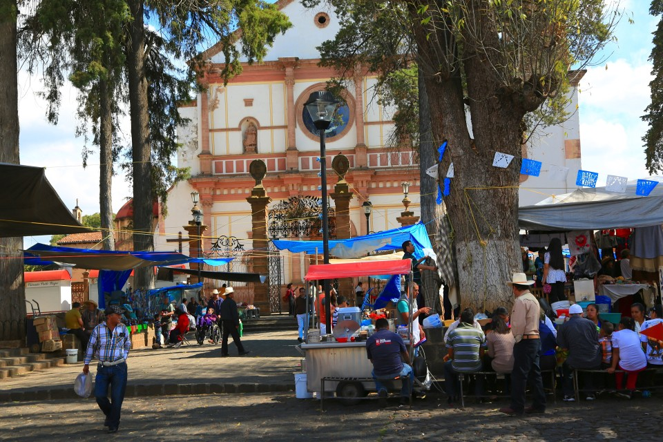 This is not a really pretty picture, but to me it gives a sense of what it is like in Mexico. food stands surrounding the churches, men in cowboy hats. Organized chaos.