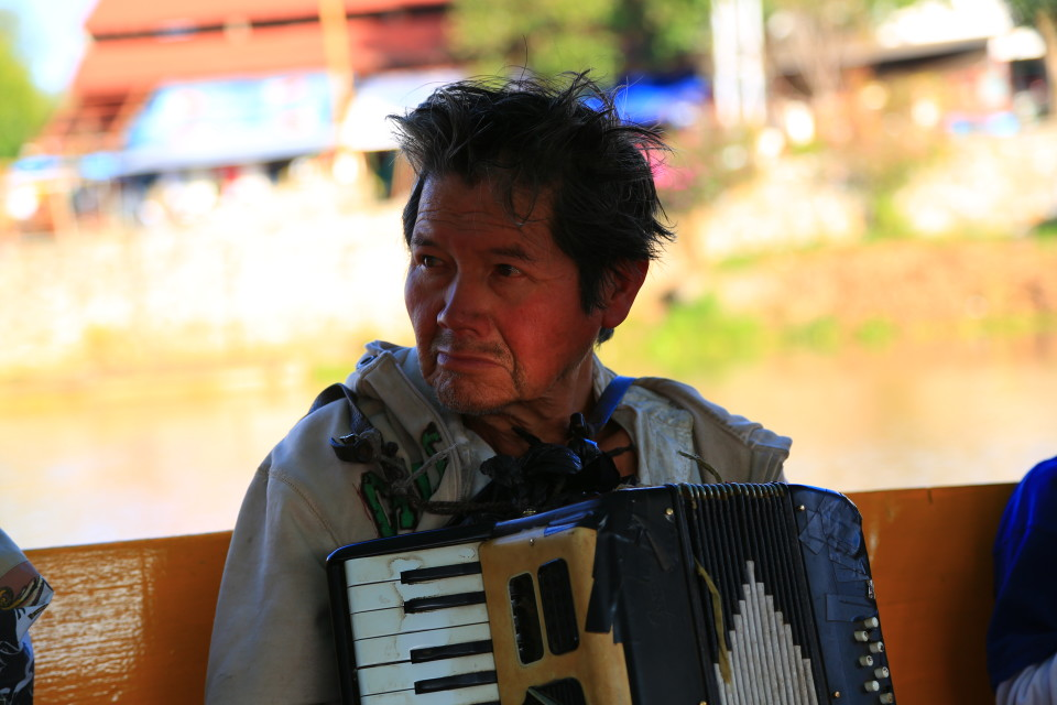 I loved this man. He wore his life on his face. I am sure things are not easy for him, but at least he had his music. He played the accordion on the boat and we were the only ones who gave him a tip.