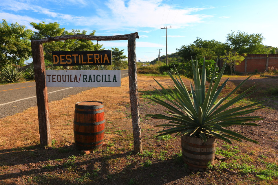 MexicoPlayaTenacatitaRaicillaDistillerySign 960x640 Raicilla, rain and a crook who stole a beach