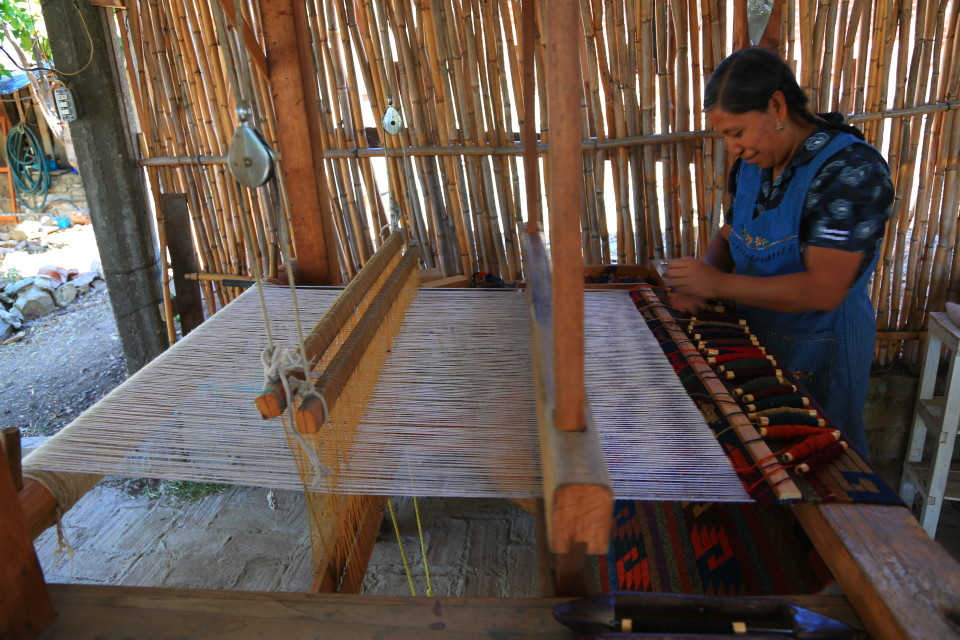 A Zapotec woman weaving. We bought a few carpets here, one is in the XP.