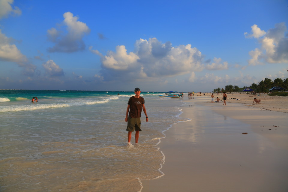 Sam pauses for a picture while walking along the beach near Tulum.