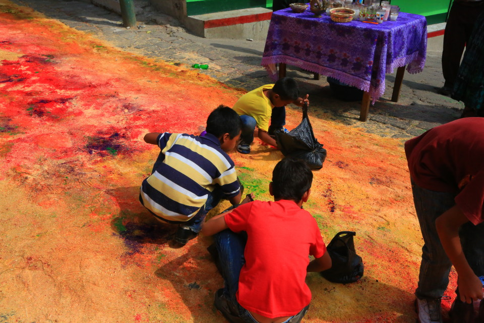 I am not sure what these boys are going to do with bags of colored sawdust. I wished I asked them.