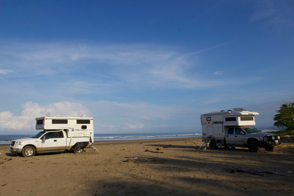 Moby and Hero parked on a beach along the Nicoya Peninsula.