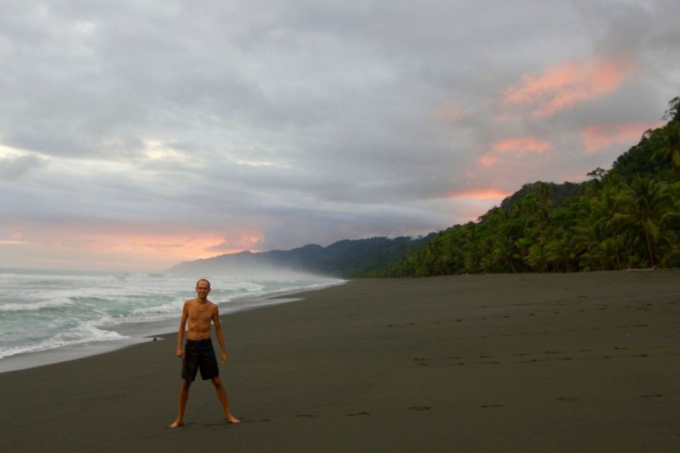 Sam on a stretch of endless beach, Corcovado is behind him.