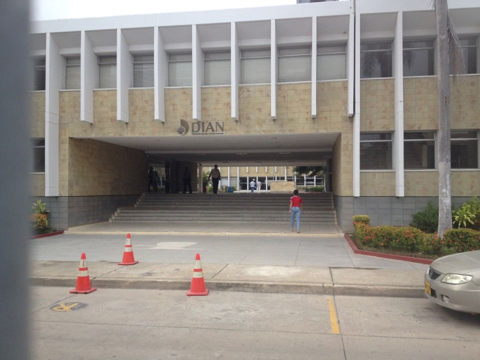 A picture of the DIAN building outside the gate.  You'll walk through the tunnel and to the building beyond, where you'll take a left in order to get to the Vehicle Import desk.