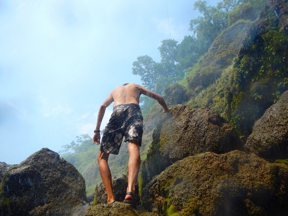 Climbing up slippery rocks to jump into a shallow pool. Why not =).