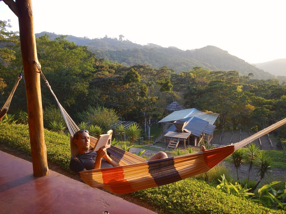 Sam relaxing in the hammocks overlooking the stunning valleys and mountains.