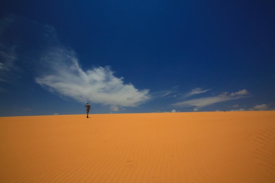 Sam running up the dunes.