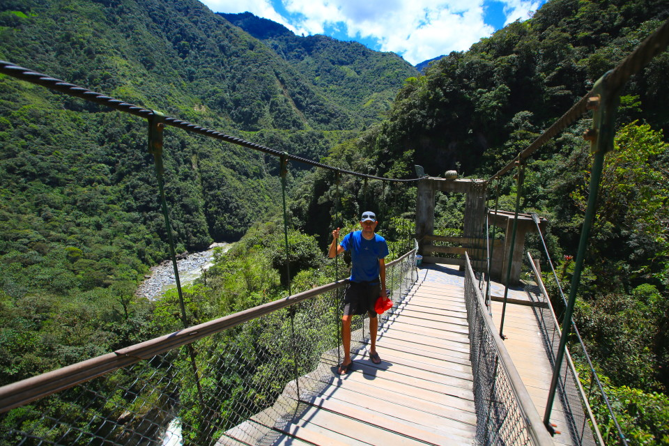 Sam on one of the suspension bridges over the falls. This area of Ecuador was lush and green.