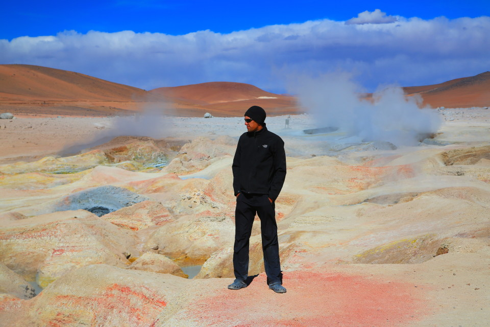 Sam at the geysers Sol de Mañana (as the name implies, the geysers are the biggest in the morning before the sun heats up the air temperature).