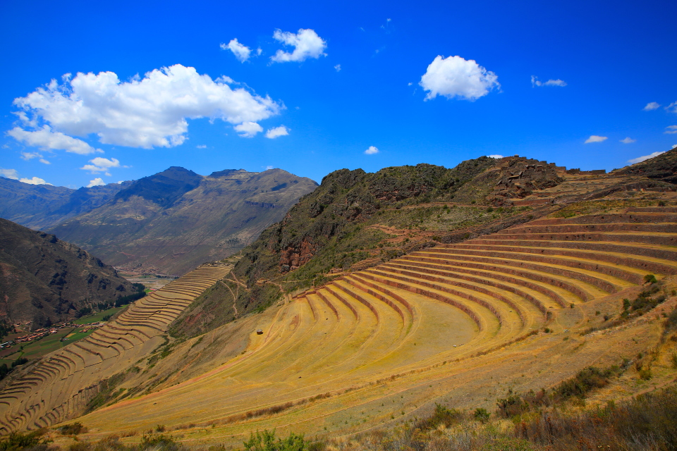 The terraces of Pisac. On the end of that point is the fortress and there are also ruins on top of the hill and below it.