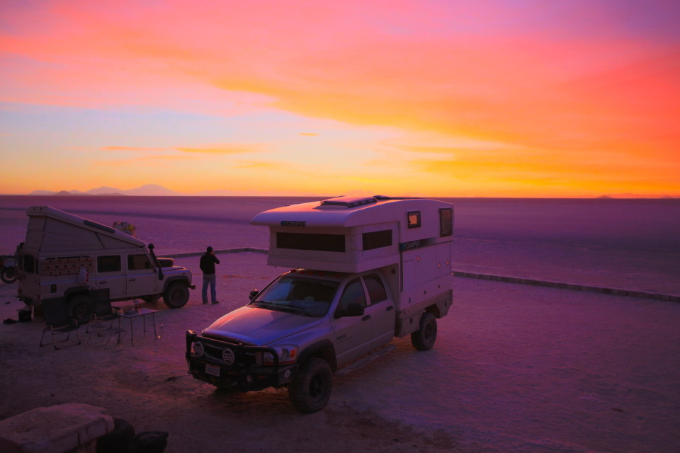 The sun turned the sky pink and then as it went down it turned the entire salar purple.