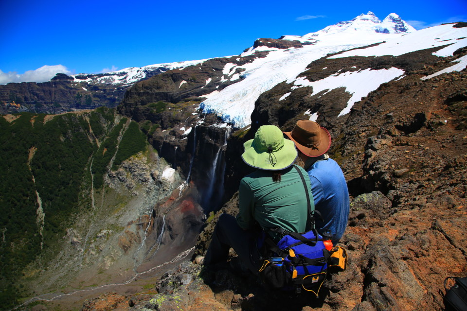 Anna and Cody taking a break to watch the glacier. We heard some huge cracks and explosions while we were hiking. The glacier was calving down the cliff face.