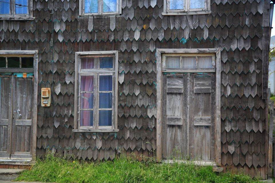 Peeling paint off an old shingled house. I am sure the elements here are brutal on the wood.