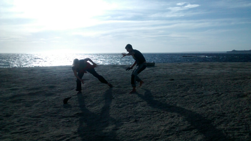 Picture from John. This is Betti and I chasing my XP hat as the crazy wind tried to blow it into the ocean.